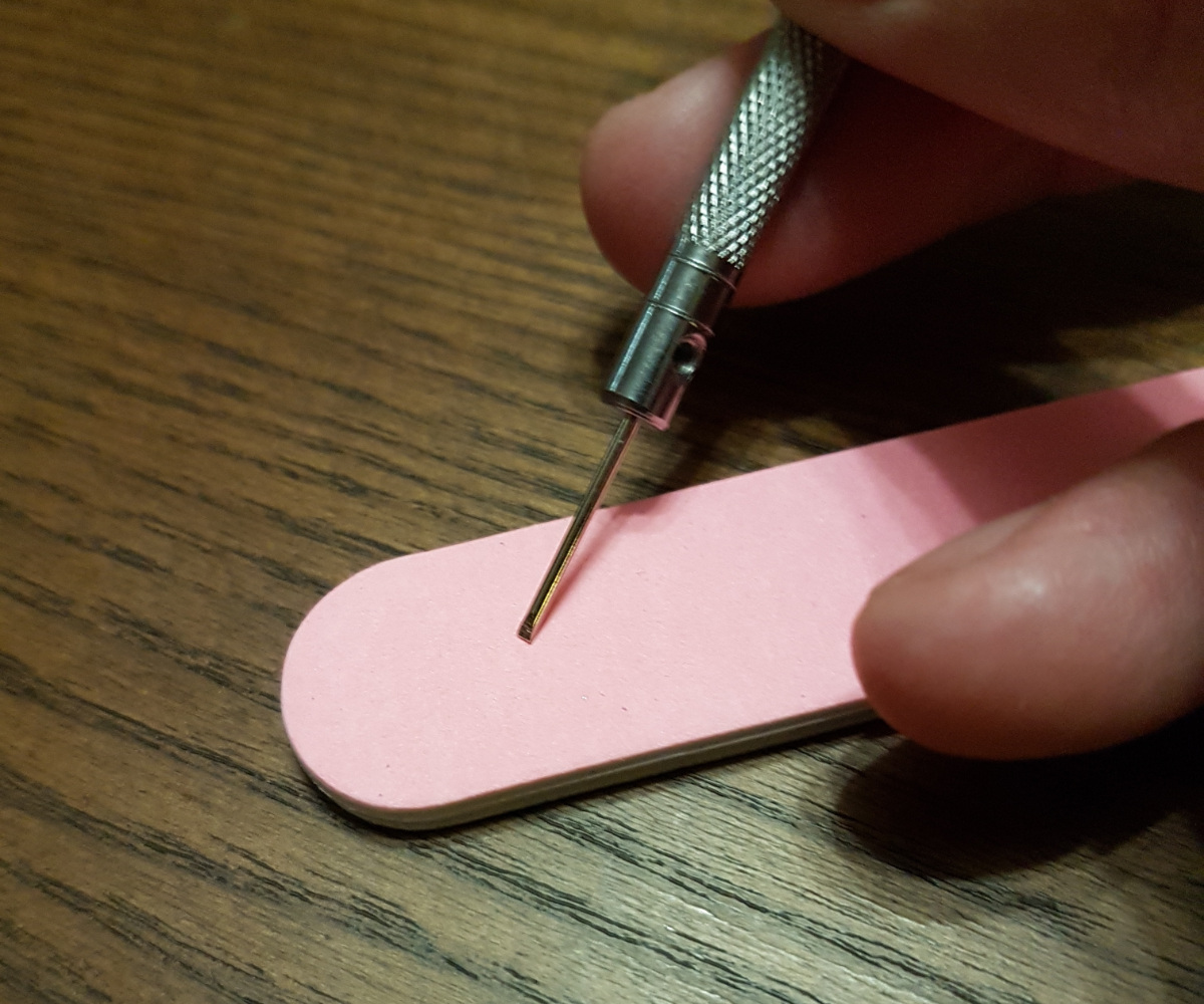 Nail file used to make a screw driver